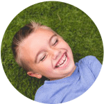 boy with big smile from Lincoln family dentists