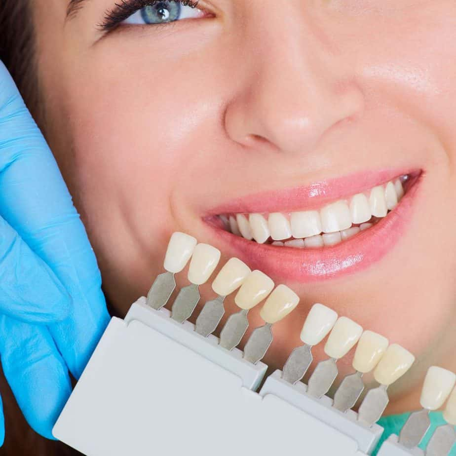 Image of a patient who is exploring her shade options when it comes to teeth whitening.