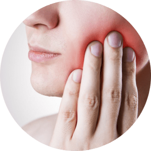 Image of a lady holding her jaw, experiencing a completey normal toothache after fillings and throbbing tooth pain after fillings.