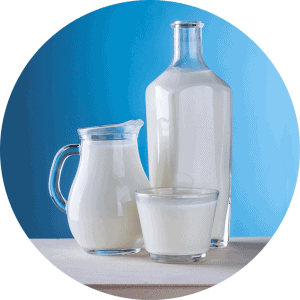 Image displaying a glass of milk, pitcher of milk , and a carafe of milk. Helping promote the question regarding milk and teeth healh.