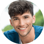 young man bright smile wondering Dental Bridge Vs Dental Implant